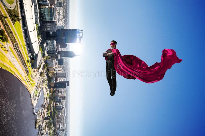 Super man in sky royalty free stock image