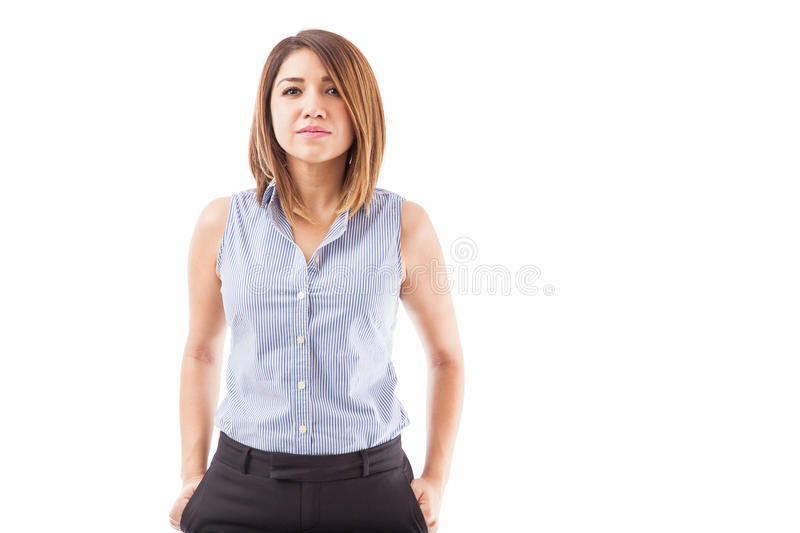 Young and confident businesswoman. Portrait of an attractive, young and confident businesswoman dressed casually on a white background stock images