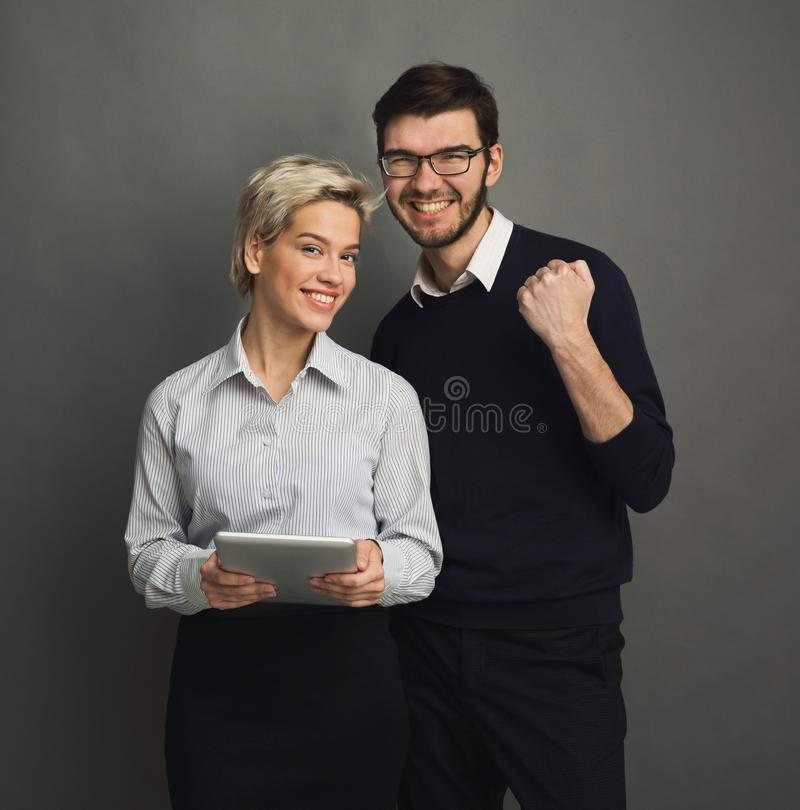 Young confident couple with digital tablet royalty free stock photos