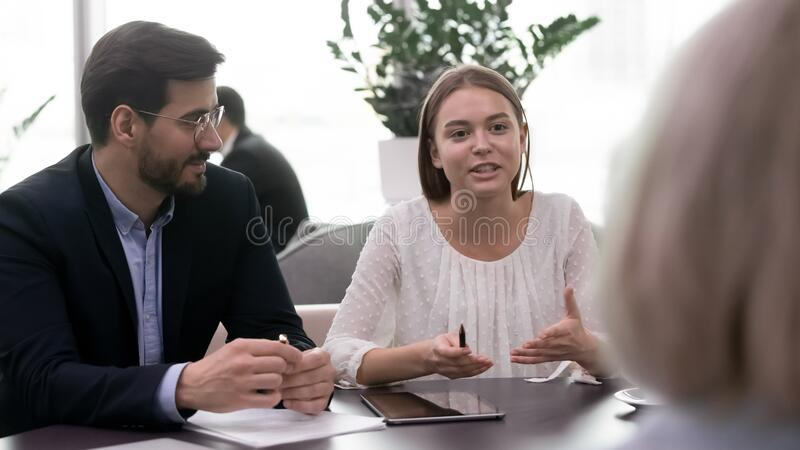 Young confident female manager asking questions explaining project ideas. royalty free stock images