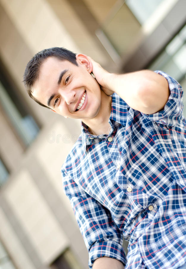 Young confident man with hand behind head stock photography