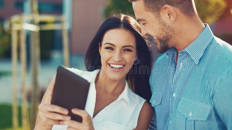 Young confident mordern businesswoman with man in city stock image
