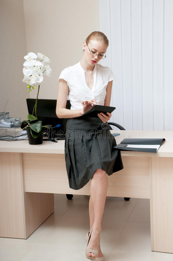 Young confident secretary. royalty free stock image
