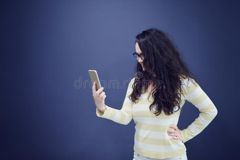 Young, confident, successful and beautiful business woman with the mobile phone isolated royalty free stock image