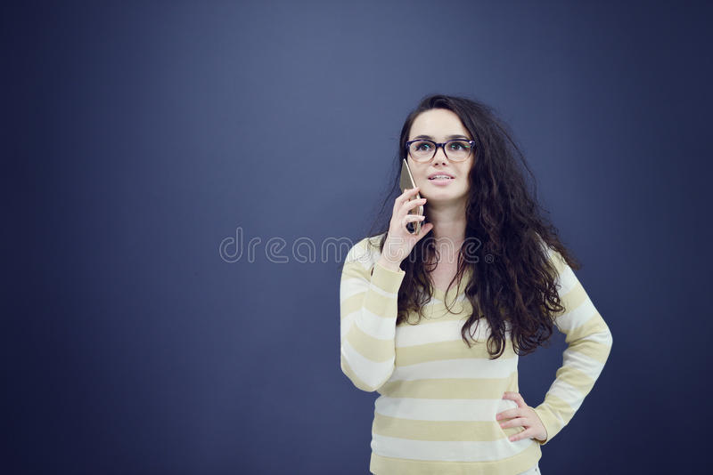 Young, confident, successful and beautiful business woman with the mobile phone isolated royalty free stock photos