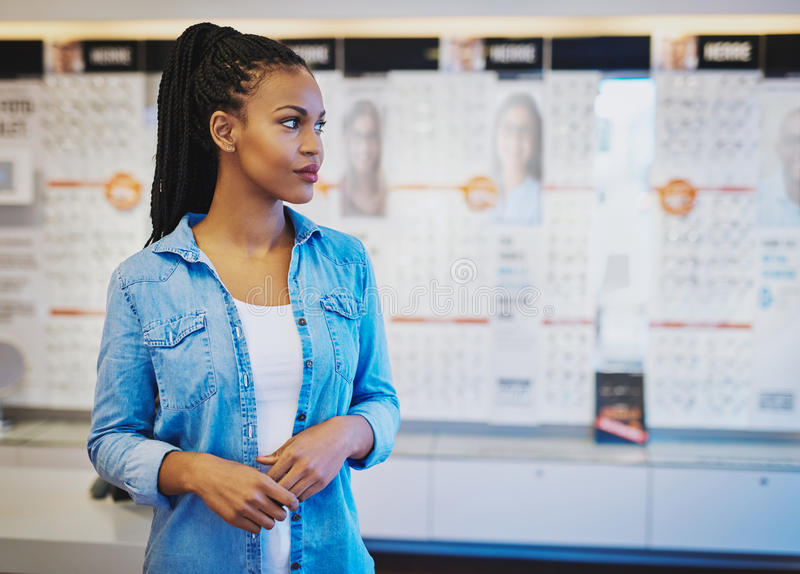Young confident woman opening own store. Young confident women opening own store, black female entrepreneur royalty free stock photography