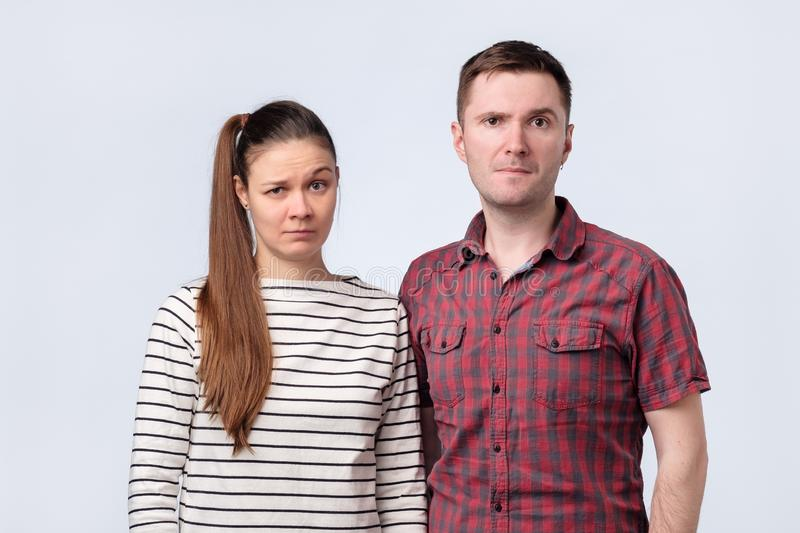 Young confused couple looking puzzled at camera. royalty free stock photo