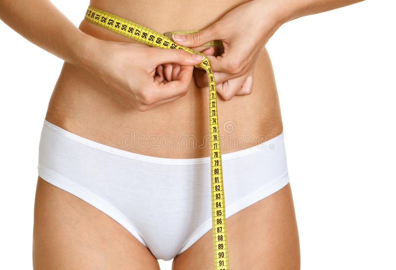 Download Young Conscious Woman Measuring Her Waist Stock Photo - Image of healthy, female: 26153278
