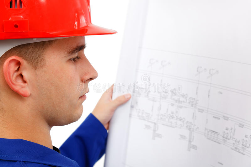 Download Young Construction Engineer Surveying Plans Stock Photo - Image: 16734590