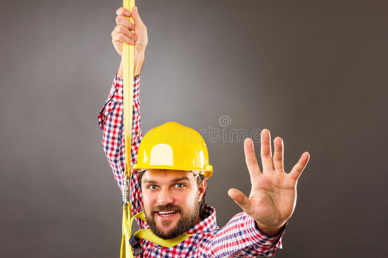 Young construction man withhard hat wearing a fall protection h royalty free stock photos