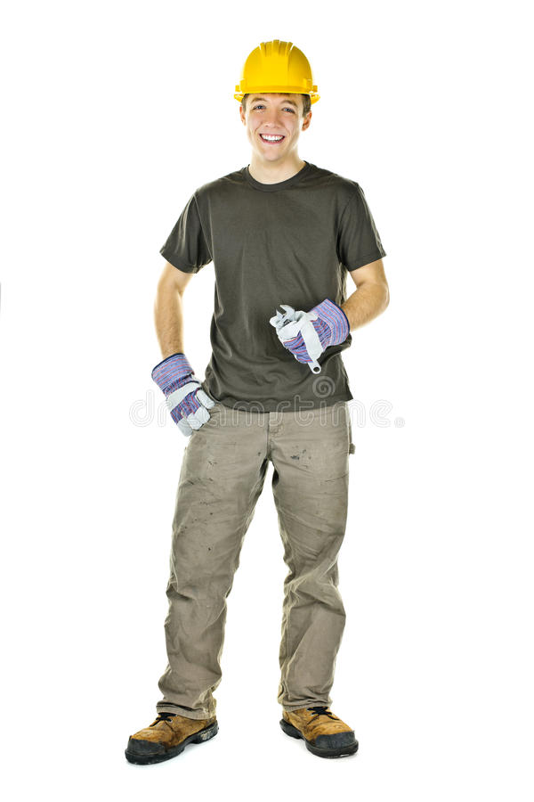 Young construction worker smiling royalty free stock photography