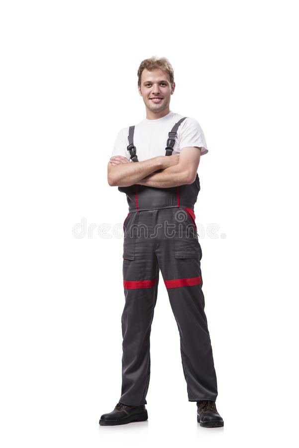 The young construction worker wearing coveralls isolated on white. Young construction worker wearing coveralls isolated on white royalty free stock photos