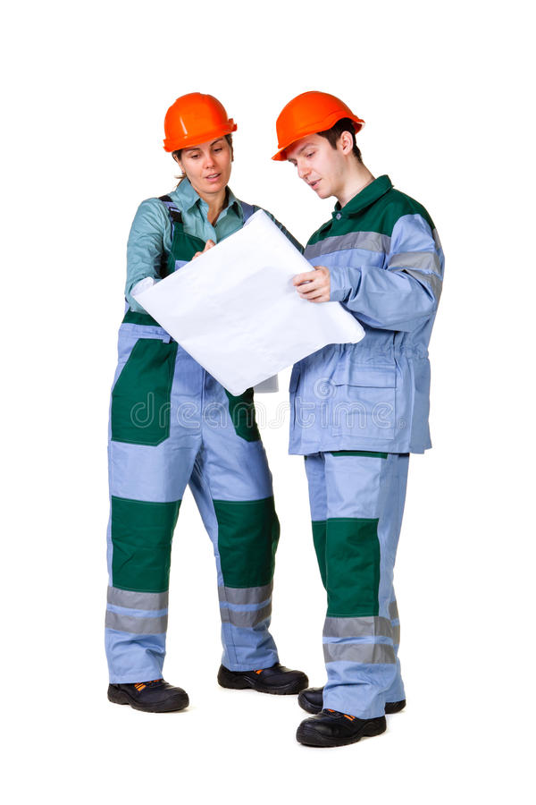 Young construction workers with blueprint royalty free stock photos