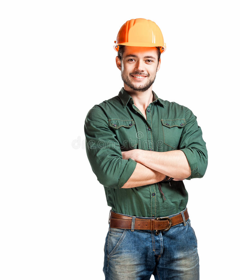 Young construction workers in hard hats royalty free stock image