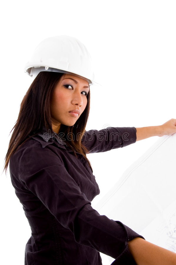 Young constructor holding blue prints. And looking at camera with white background stock photos