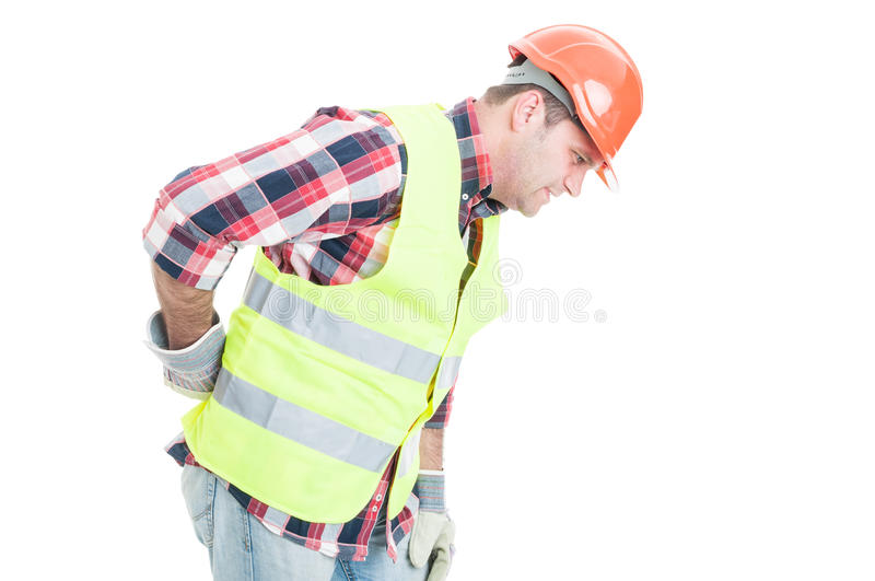 Young constructor suffering form back pain stock image
