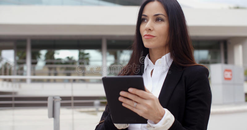 Young contemplative businesswoman stock images