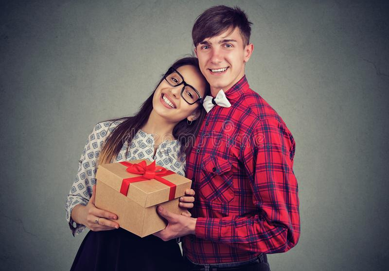 Happy couple with present on anniversary royalty free stock photos