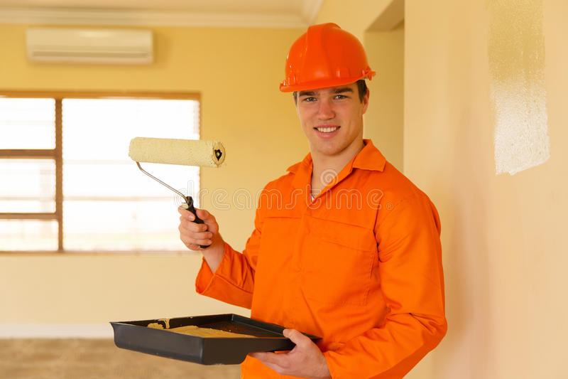Young contractor painting stock images