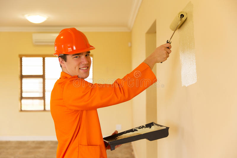 Young contractor painting royalty free stock photos