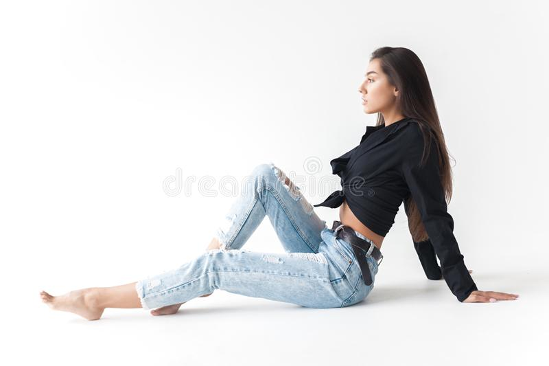 Young cool hipster girl in black shirt and blue banana jeans on royalty free stock photos