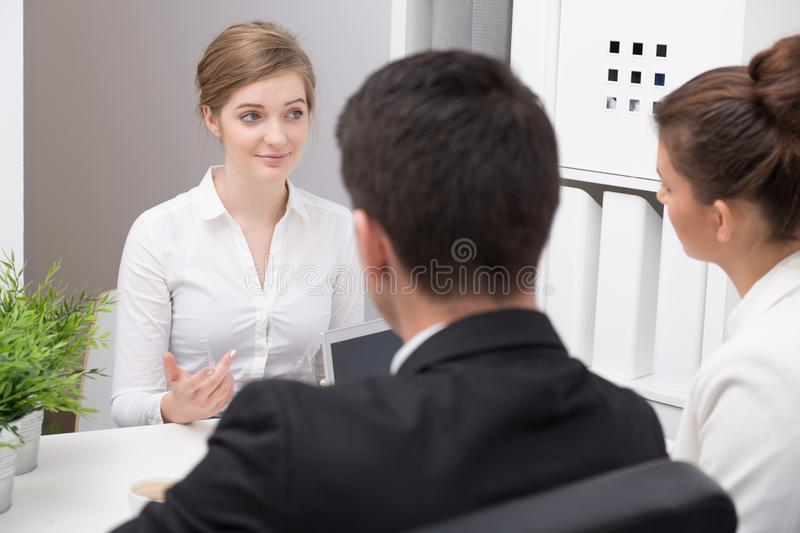 Young corporate workers discussing project stock photos