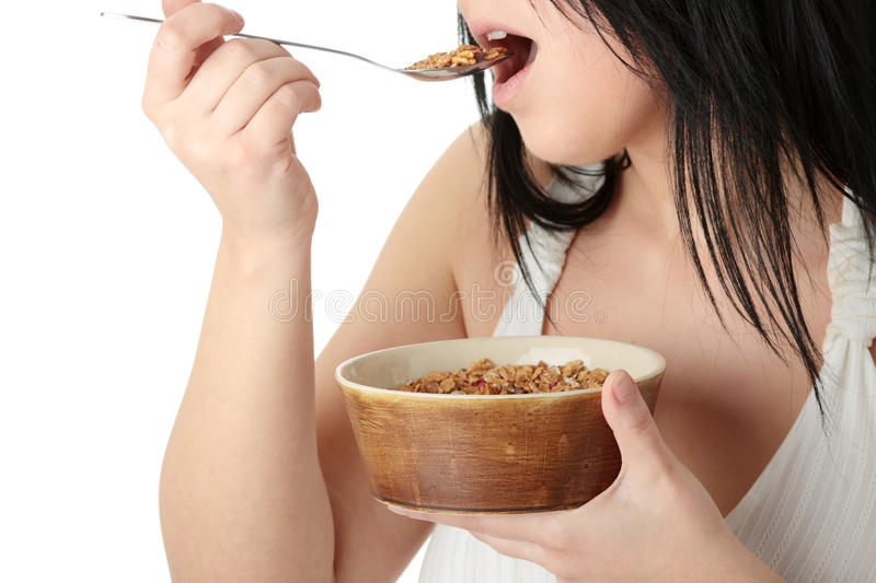 Young corpulent woman eating muslin royalty free stock photo