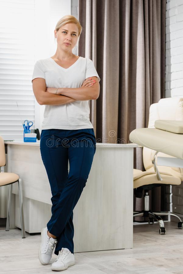 Young cosmetologist in office stock photos