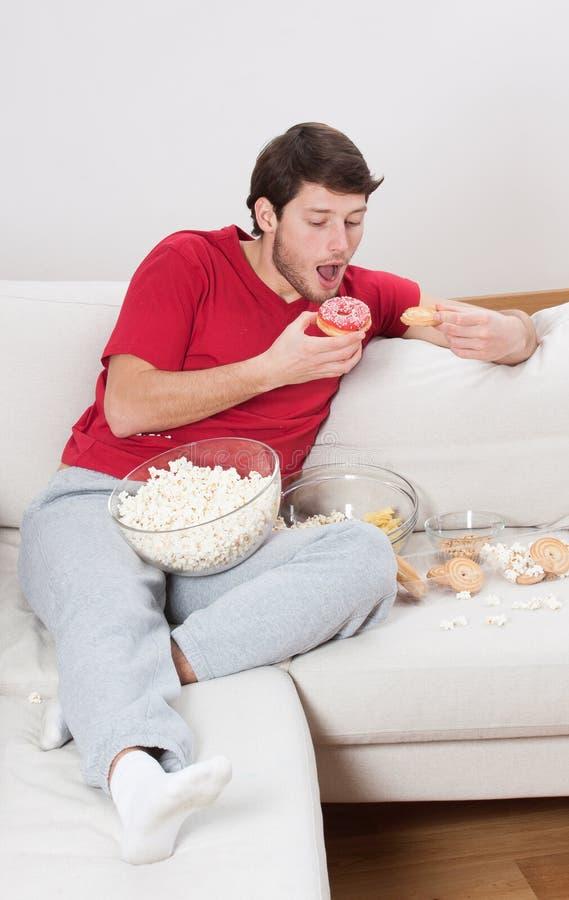 Young couch potato stock photos