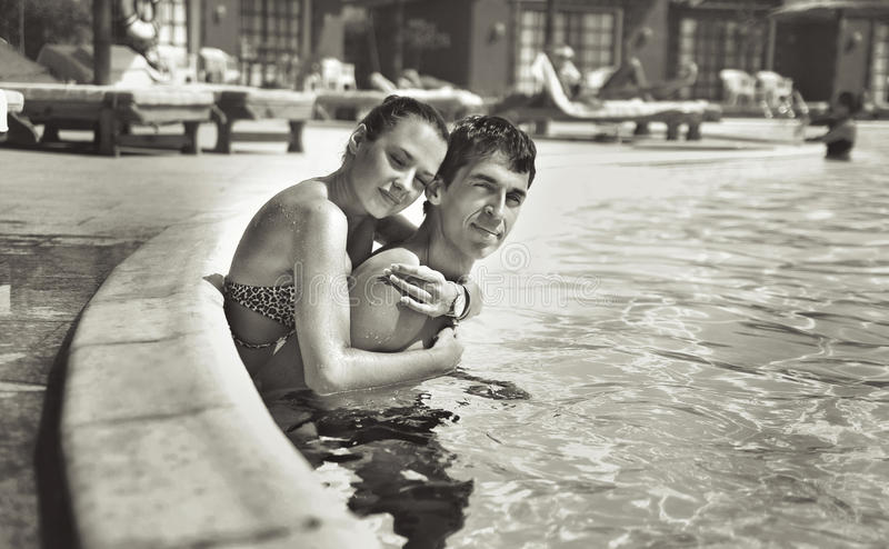 Young couple. Having fun in a swimming pool royalty free stock image
