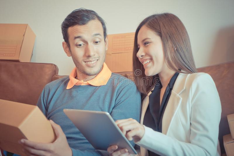 Young couple addited to online shopping, full of deliveried b royalty free stock photos