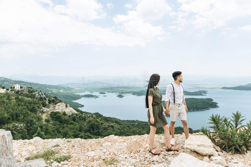 Young couple admires the landscape royalty free stock image