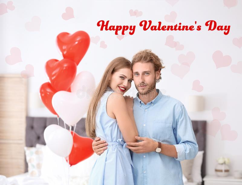 Young couple with air balloons in bedroom.Saint Valentine`s Day royalty free stock photo