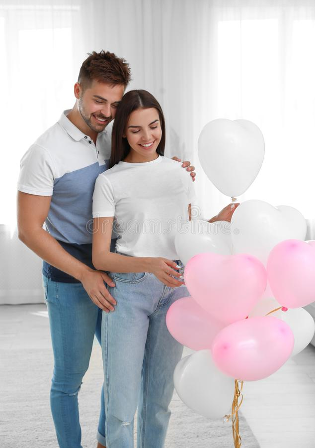 Young couple with air  at home. Celebration of Saint Valentine`s Day royalty free stock photos