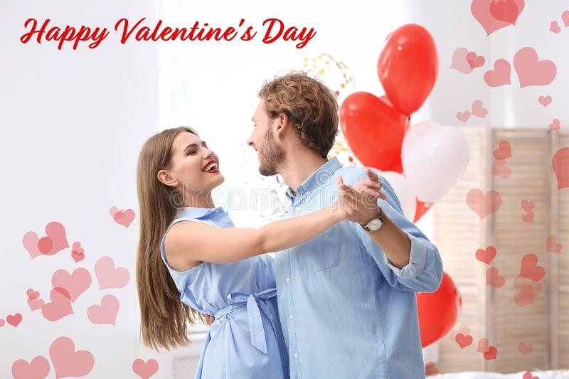 Young couple with air balloons. Celebration of Saint Valentine`s Day royalty free stock photos