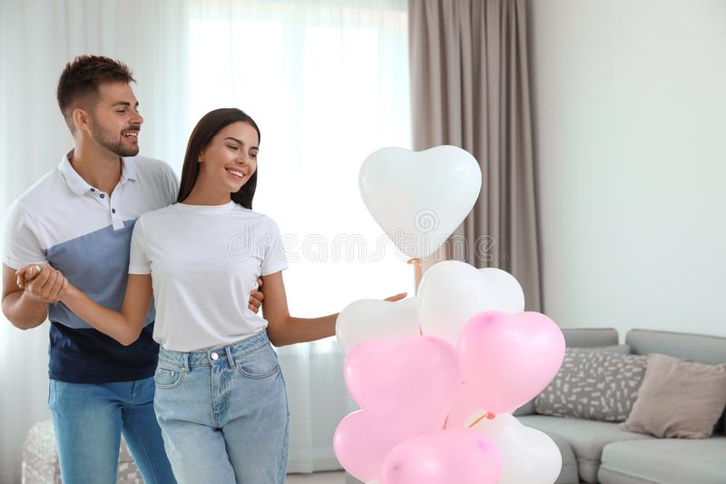 Young couple with air balloons at . Celebration of Saint Valentine`s Day royalty free stock images