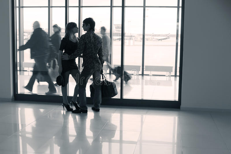 Young couple in airport royalty free stock photo