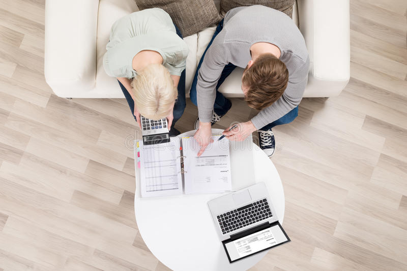 Young Couple Analyzing Invoices royalty free stock photos