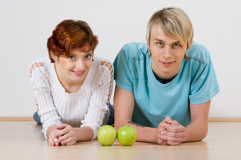 Young couple and apples royalty free stock photos