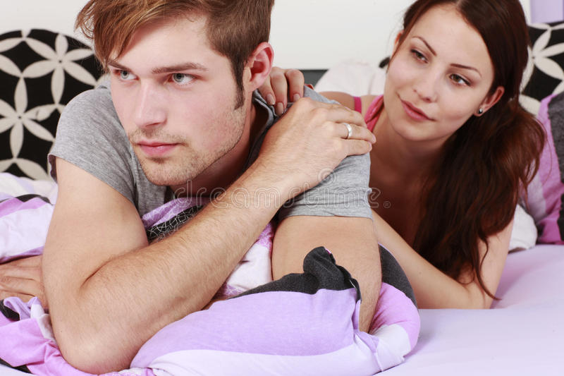 Young couple argue. Young couple in hassle in the bedroom royalty free stock image