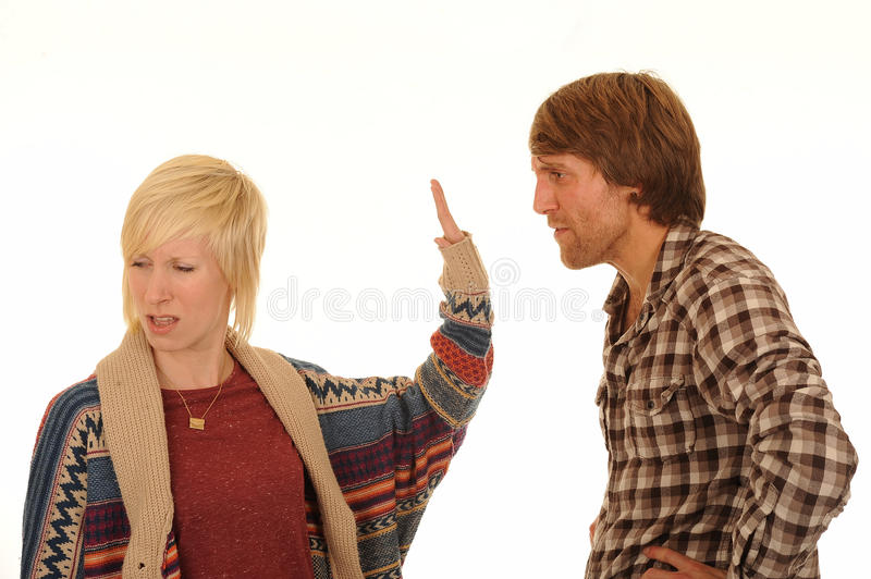 Young couple arguing. Half body portrait of young couple arguing, isolated on white background royalty free stock photo