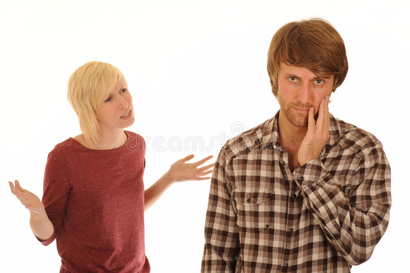 Young couple arguing. Half body portrait of young couple arguing, woman gesturing with hands, isolated on white background stock photo
