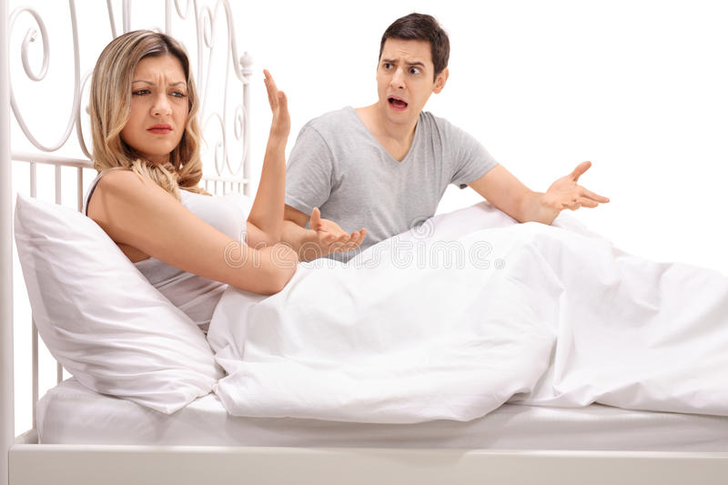 Young couple arguing in bed royalty free stock image
