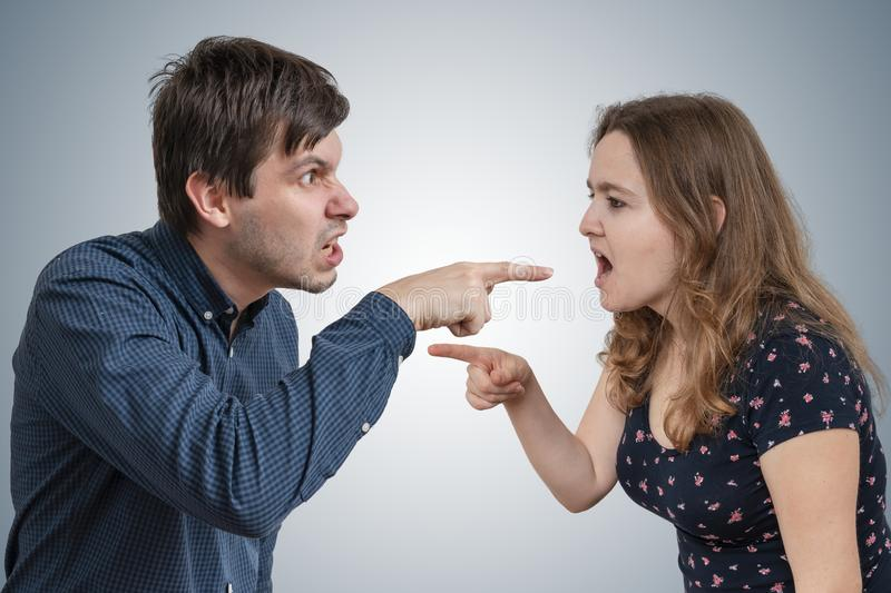 Young couple is arguing and blaming each other.  stock photos