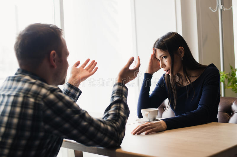 Young couple arguing in a cafe. Relationship problems. Young couple arguing in a cafe. Relationship problems royalty free stock photo