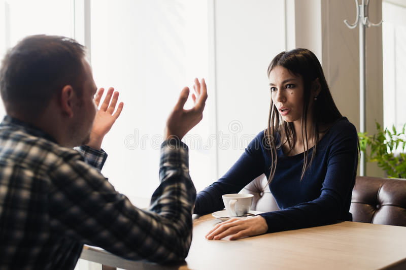 Young couple arguing in a cafe. Relationship problems. Young couple arguing in a cafe. Relationship problems royalty free stock photos