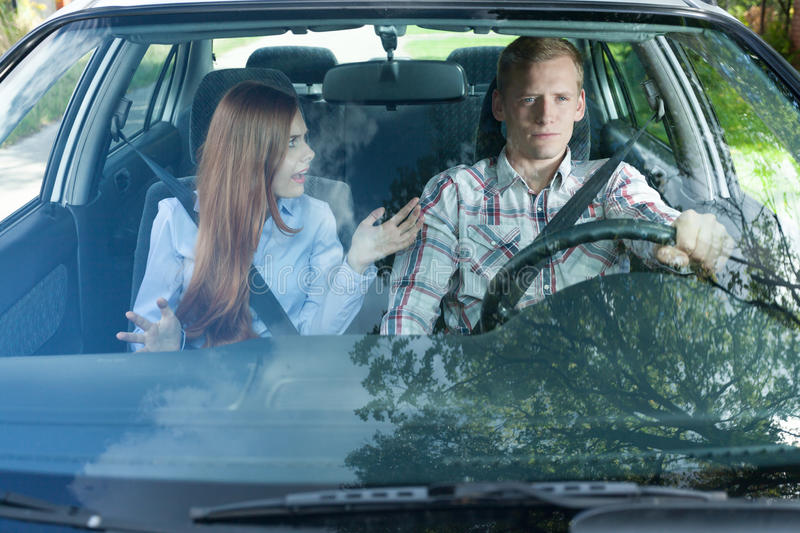Young couple arguing in car stock image