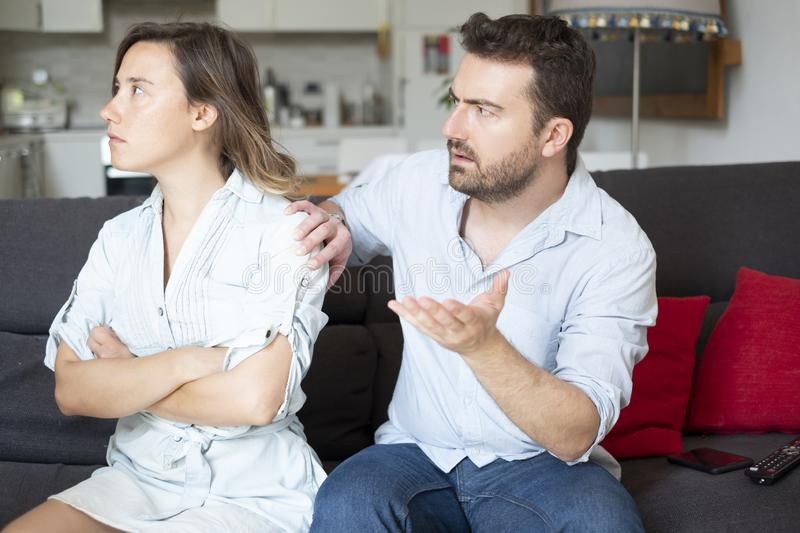 Young couple arguing at home needs couples therapy. Relationship breakup and couple fighting badly stock photo