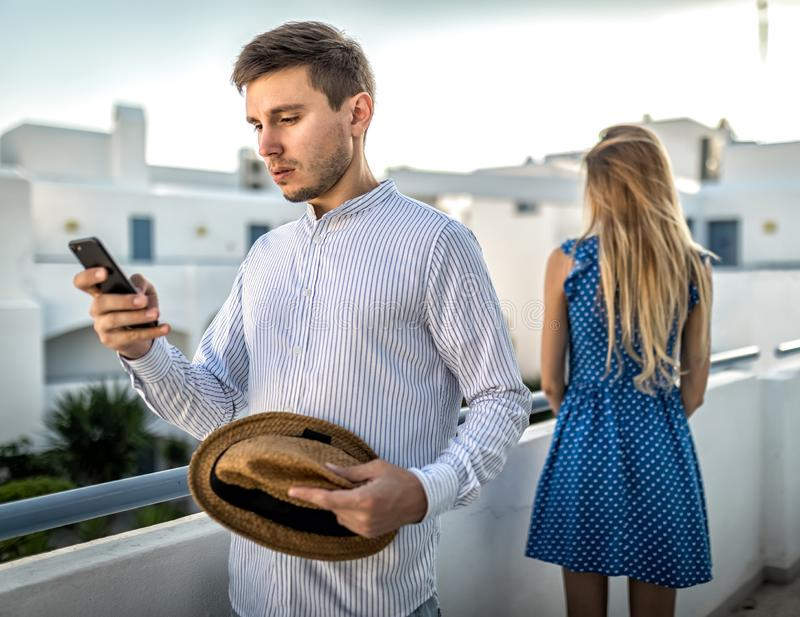 Young couple arguing, quarrel over phone. Girl offended, resentment, betrayal contradictions in relationships, suspicion treason,. Intuition, distrust. Partner royalty free stock image