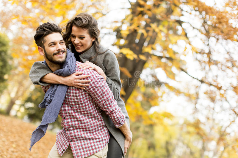 Young couple in the autumn forest stock photography